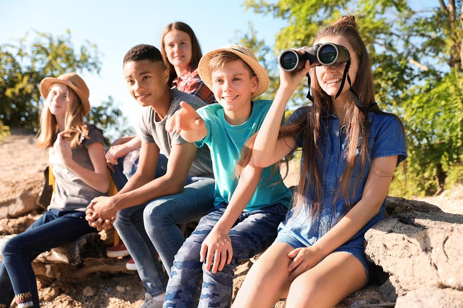 bigstock-Group-Of-Children-With-Binocul-244248319